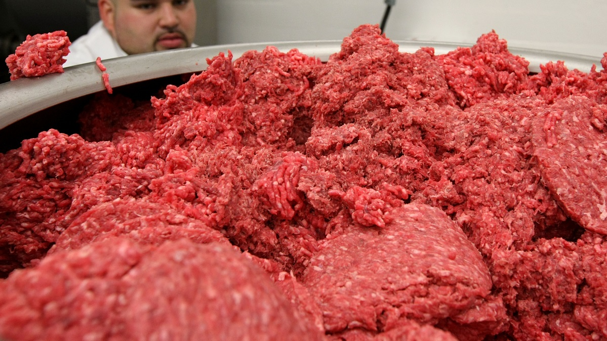 SAN FRANCISCO - JUNE 24: Carlos Vasquez monitors ground beef as it passes through a machine that makes hamburger patties at a meat packing and distribution facility June 24, 2008 in San Francisco, California. Livestock owners are experiencing a sharp increase in the price of corn-based animal feed as corn and soybean prices skyrocket due to an estimated 2 million acres of crop damage from the recent Midwest flooding and the continually rising fuel costs. Due to the increase in feed costs, consumers which will get hit in the wallet as prices of meat, dairy and eggs are expected to increase sharply. (Photo by Justin Sullivan/Getty Images)