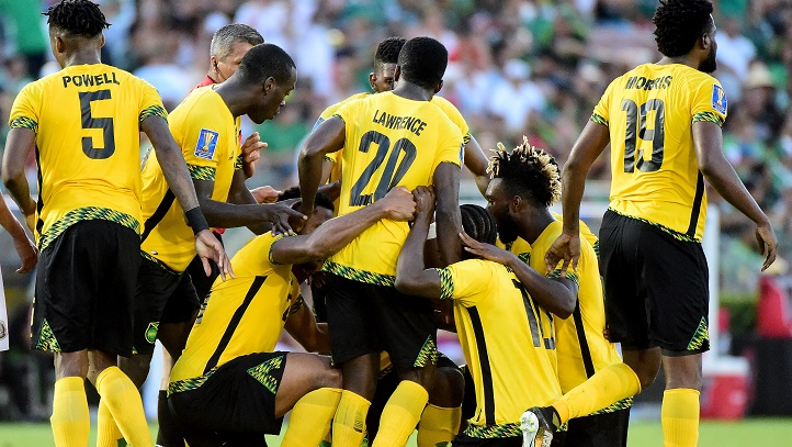 Kemar Lawrence #20 celebrates his goal, to take a 1-0 lead over Mexico, with his teammates during the CONCACAF 2017 semifinal at Rose Bowl on July 23, 2017 in Pasadena, California. Jamaica won 1-0. (Photo by Harry How/Getty Images)