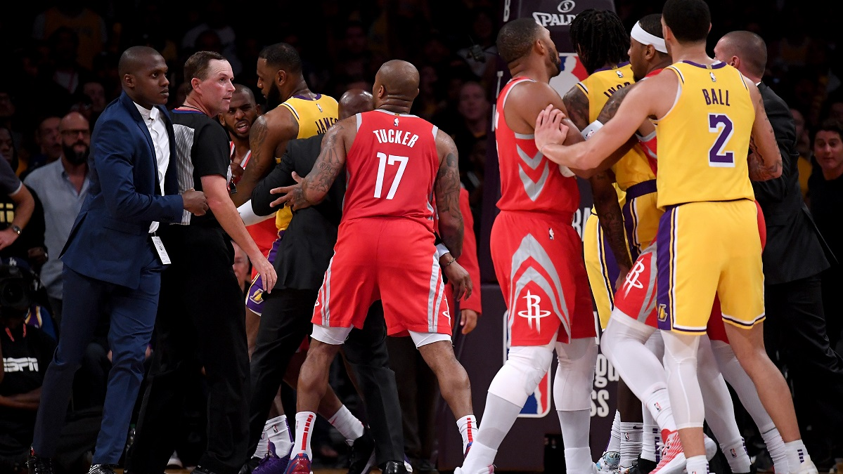 Chris Paul #3 of the Houston Rockets is restrained by LeBron James #23 of the Los Angeles Lakers after a fight involving Rajon Rondo #9 and Brandon Ingram #14 of the Los Angeles Lakers during a 124-1115 Rockets win at Staples Center on October 20, 2018 in Los Angeles, California. (Photo by Harry How/Getty Images)