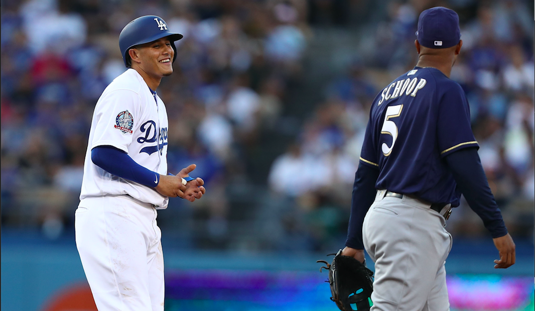 Manny Machado #8 of the Los Angeles Dodgers shares a laugh with Jonathan Schoop #6 of the Milwaukee Brewers. Both teams (and players) will meet in the NLCS with a trip to the World Series on the line.