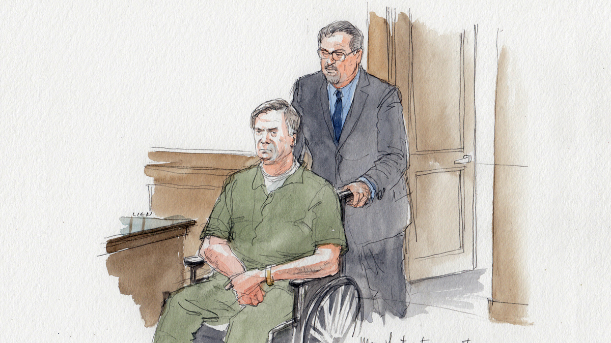 Paul Manafort enters courtroom in a wheelchair. White sock or bandage on right foot.