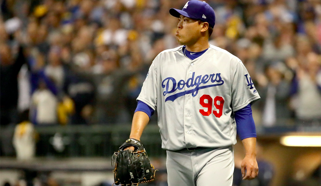 Hyun-Jin Ryu #99 of the Los Angeles Dodgers reacts against the Milwaukee Brewers during the first inning in Game Six of the National League Championship Series at Miller Park on October 19, 2018 in Milwaukee, Wisconsin. (Photo by Jonathan Daniel/Getty Images)