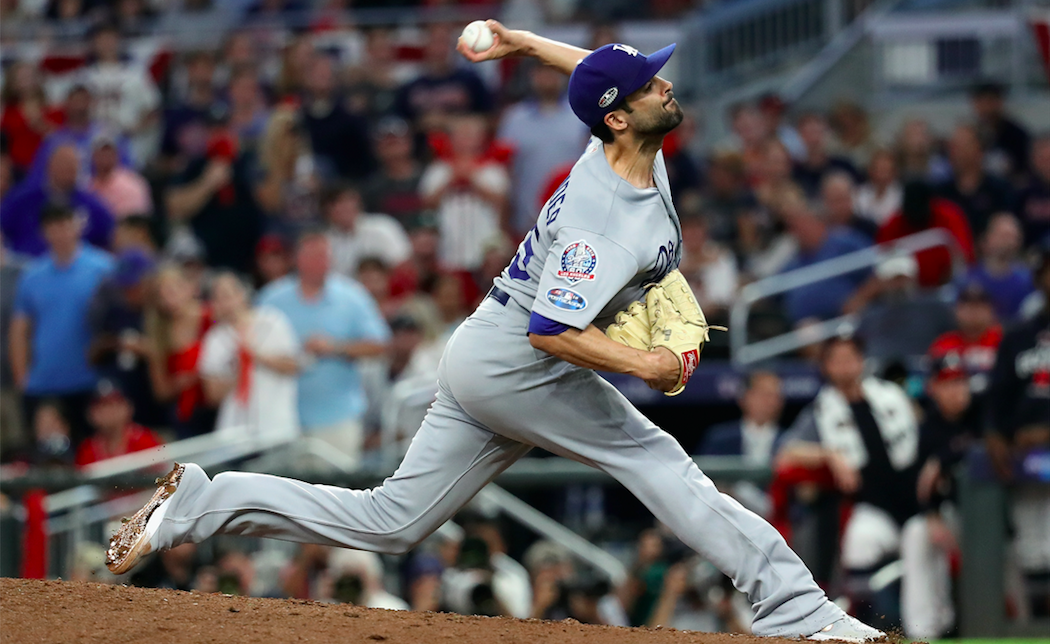 Scott Alexander #75 of the Los Angeles Dodgers pitches in the eighth inning against the Atlanta Braves during Game Three of the National League Division Series at SunTrust Park on October 7, 2018 in Atlanta, Georgia. (Photo by Rob Carr/Getty Images)