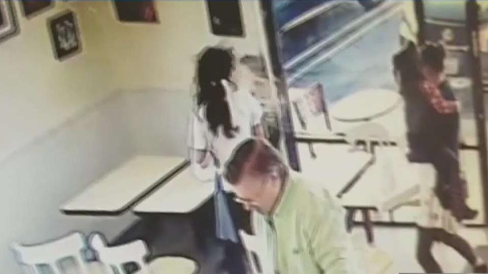 Woman caught attacked a store owner with a cup of coffee at a Spudnuts Donuts in Canoga Park.