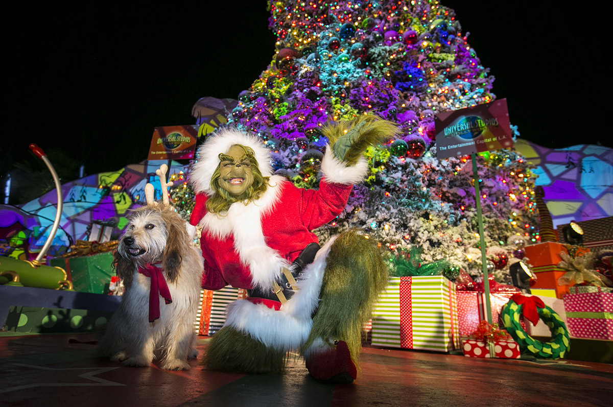The Grinch and his faithful dog Max pose for a photo during Grinchmas 2018 at Universal Studios Hollywood.