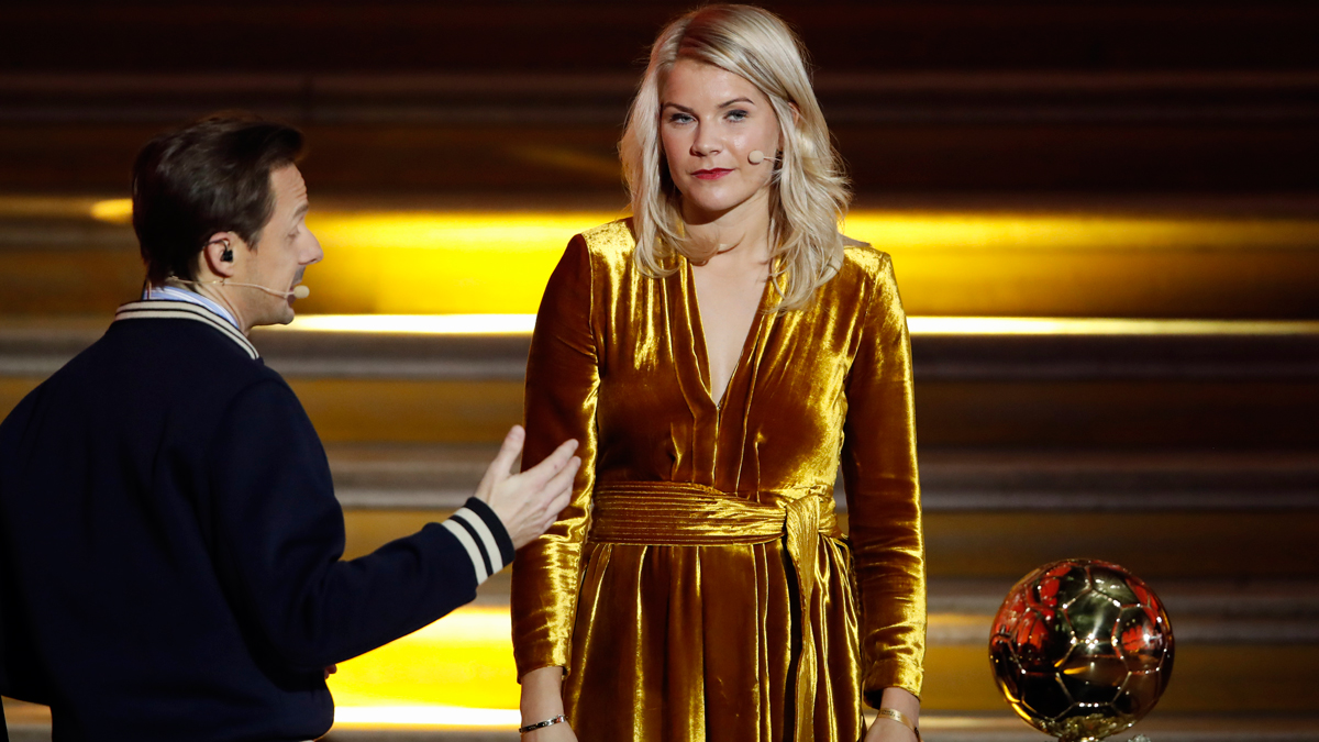 In this photo taken Monday Dec.3, 2018, French DJ and musician Martin Solveig, left, talks to Olympique Lyonnais' Ada Hegerberg, of Norway, during the Golden Ball (Ballon d'Or) award ceremony at the Grand Palais in Paris. After asking the first woman to win the Ballon d'Or if she twerked, French DJ Martin Solveig then said sorry.
