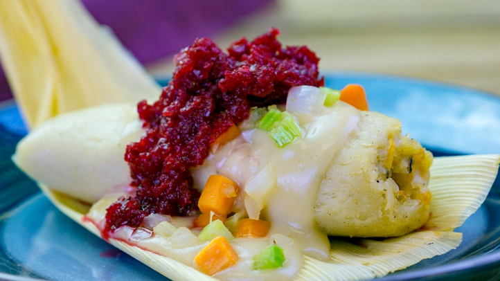 The turkey & stuffing tamale with cranberry relish can be found at the Merry Mashups marketplace during Disney Festival of Holidays at Disney California Adventure Park. The festival, taking place Nov. 9, 2018, through Jan. 8, 2019, entertains guests with the sights, sounds and tastes of diverse cultural festivities and plenty of Disney magic. Guests can stroll through the Festive Foods Marketplace and enjoy a variety of holiday comfort dishes that span cultures and family traditions. Disney California Adventure Park is located in Anaheim, Calif. (Disneyland Resort)