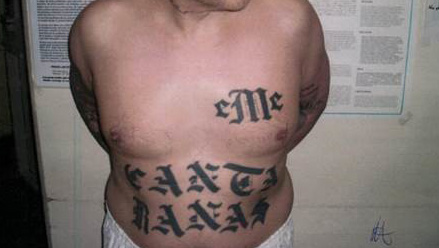 Accused Mexican Mafia Member David Gavaldon is seen in this photo in CDCR custody with the EME and Canta Ranas gang tattoos. He allegedly gave orders to other members while inside the California Institute for Men in Chino.