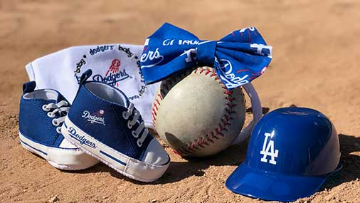 A Dodger fan couple announced the newest member on the roster during the World Series.
