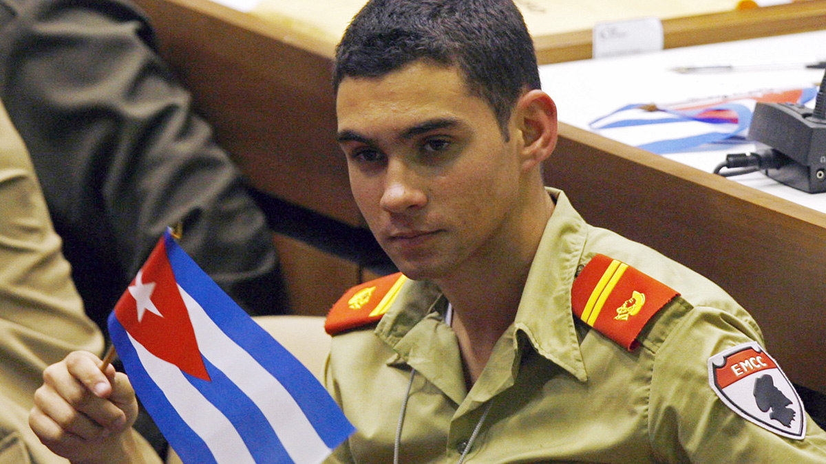 FILE - In this April 4, 2010 file photo, Elian Gonzalez holds a Cuban flag during the Union of Young Communists congress in Havana, Cuba. Gonzalez, the Cuban boy at the center of an international custody battle nearly 20 years ago in April 2000, has joined Twitter after Cuba announced 3G internet access for cell phone users.