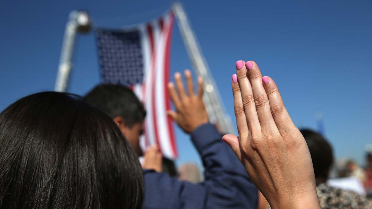 In this file photo, 100 immigrants become American citizens during a naturalization ceremony at Liberty State Park on September 17, 2015 in Jersey City, New Jersey.