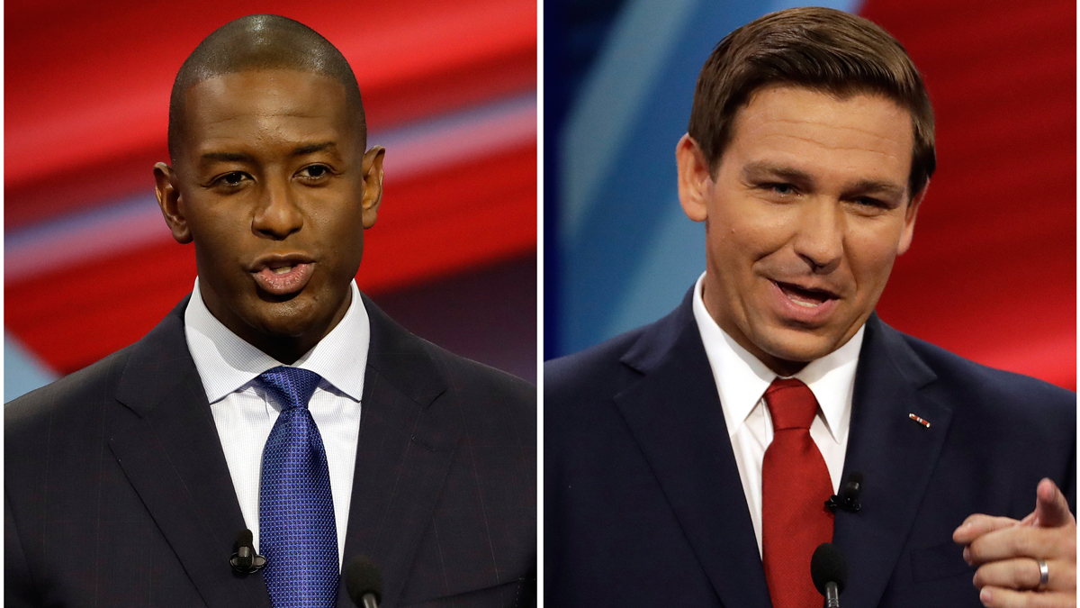 FILE - In this combination of Oct. 21, 2018 file photos Florida Democratic gubernatorial candidate Andrew Gillum, left, and Florida Republican gubernatorial candidate Ron DeSantis speak during a CNN debate in Tampa, Fla. Races for governor, legislative seats and other state-level offices have attracted more than $2 billion in campaign contributions this year. That nearly matches contributions to congressional elections, the highest profile political events this year. The top states this year for reported contributions to candidates are, in order, Illinois, California, Texas, Florida, New York, Georgia and Pennsylvania. Polls have consistently shown a tight race in Florida between DeSantis, a loyalist to President Donald Trump, and Tallahassee Mayor Gillum.