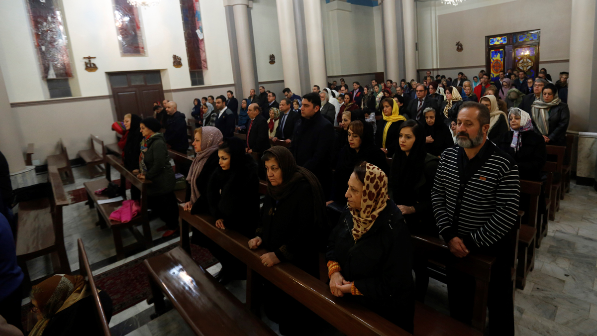 In this December 24, 2016, file photo, Iranian Christians attend Christmas Eve mass at the St Joseph Armenian Catholic church in Tehran.