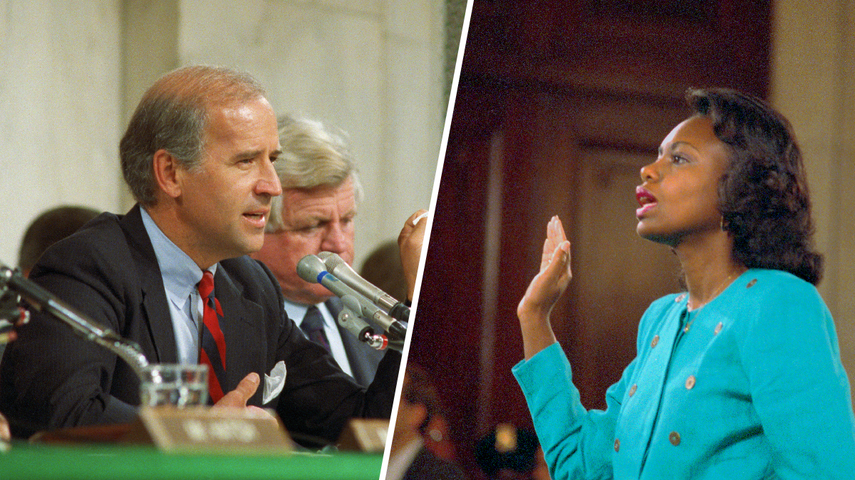Senate Judiciary Committee Chairman Sen. Joseph Biden, D-Del., holds up an FBI report on Anita Hill, seen swearing in at right, during the 1991 committee hearings on her accusations about Supreme Court nominee Clarence Thomas.