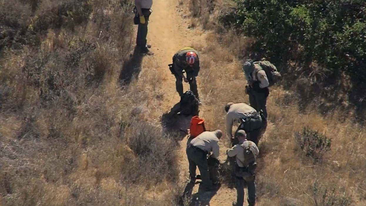 Investigators returned to a wilderness area near Malibu Creek State Park Wednesday, Oct. 16, 2018, to search for new clues in the shooting death of a camper and in a series of other seemingly random shootings.