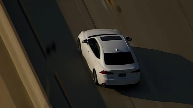 Police chased a white sedan on the 210 Freeway in the Pasadena area Friday, Nov. 15, 2018.