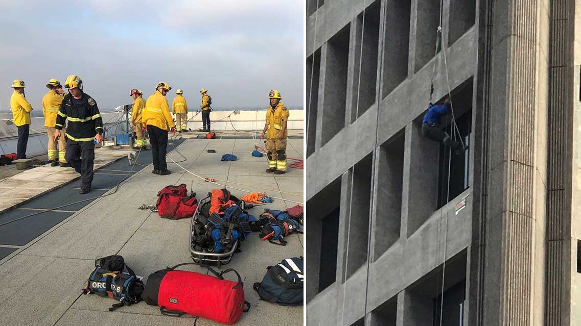 A crowd watching from the ground cheered Tuesday morning when Orange County firefighters rescued a window washer who was stranded on a rope after his scaffolding collapsed outside a nine-story building Tuesday, Oct. 23, 2018, in Santa Ana.
