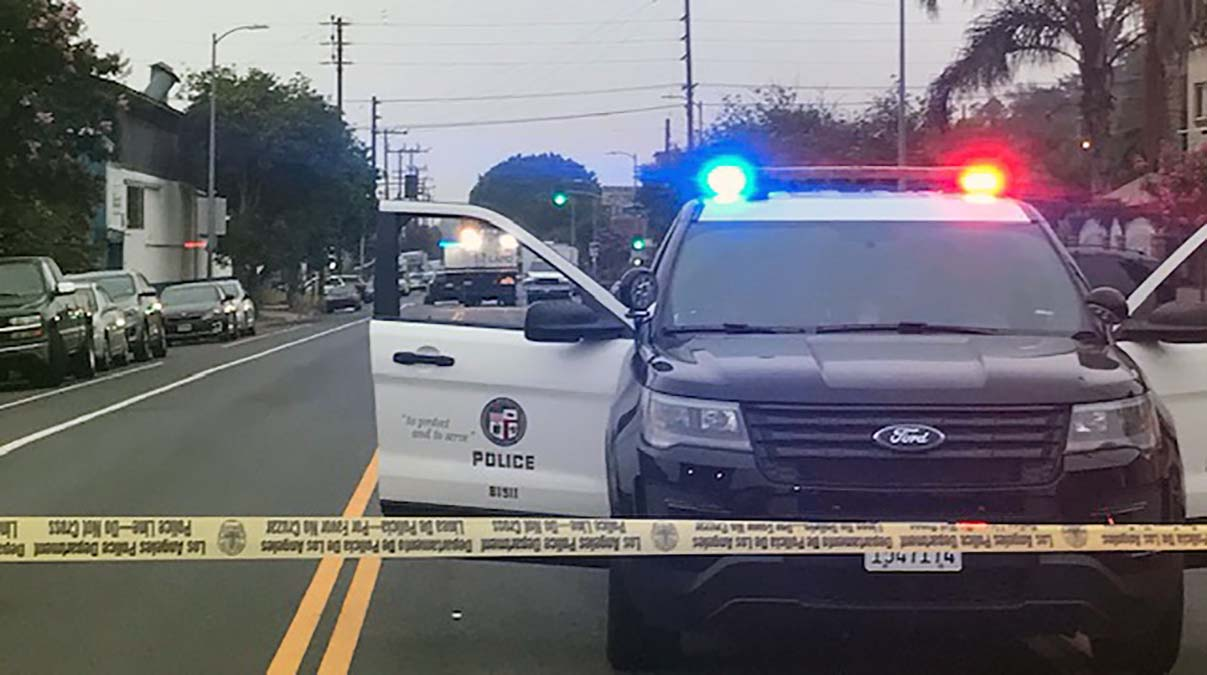 Gunman Ambushes LAPD Officers Stopped at a Traffic Light