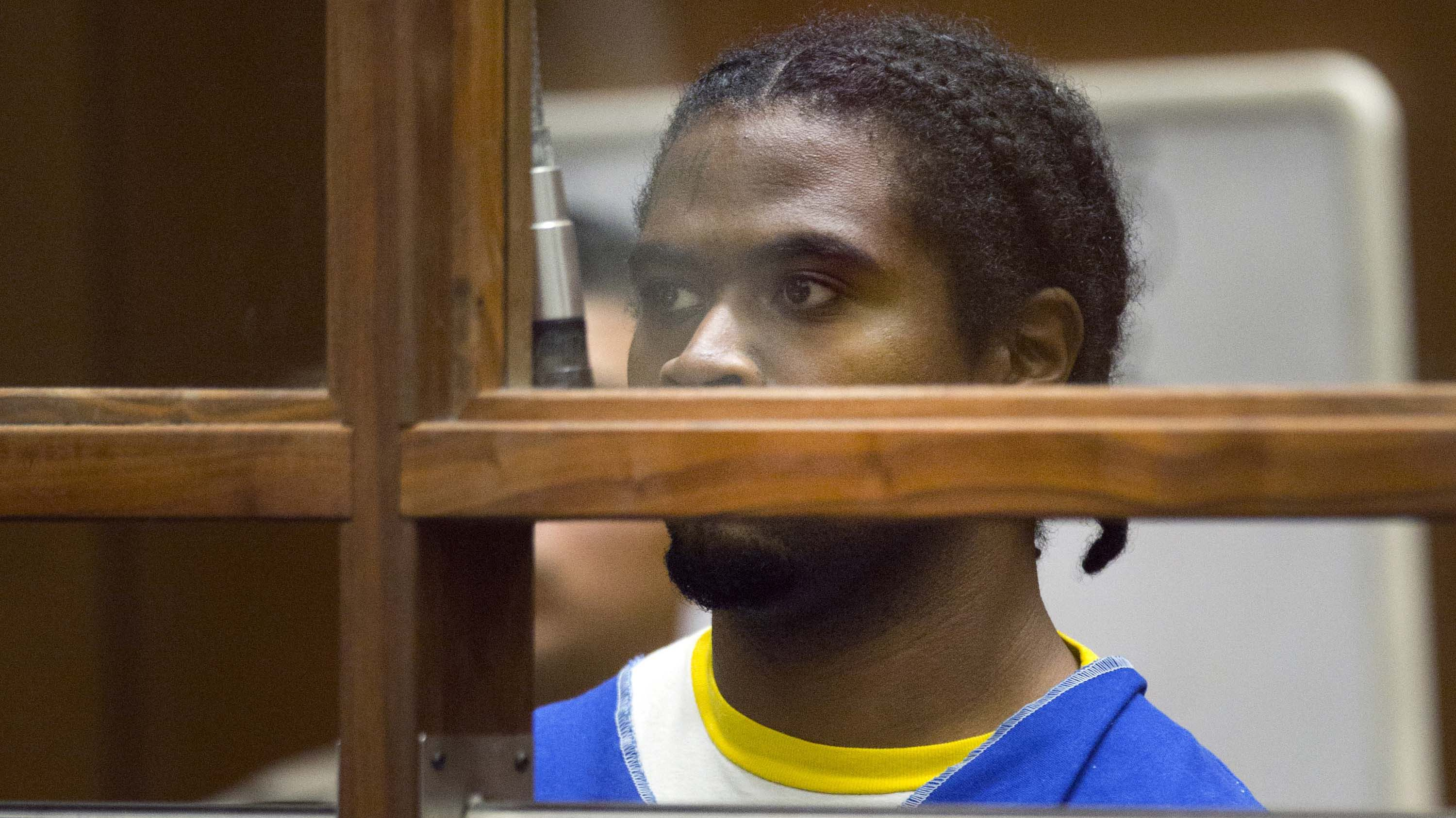 Gene Evin Atkins appears in court for the first time in Los Angeles Superior court in Los Angeles Tuesday, July 24, 2018. Police say Atkins shot his grandmother seven times, kidnapped his 17-year-old girlfriend and shot at officers as they chased his car and then as he ran into the Trader Joe's in the city's Silver Lake section on Saturday afternoon. Police Chief Michel Moore said a store worker, Melyda Corado, was killed by a police officer's bullet as Atkins exchanged gunfire with officers as he ran into the store. Prosecutors say Atkins is being charged with murder under a legal rule that his actions set into motion a series of events leading to Corado being killed. (AP Photo/Damian Dovarganes)